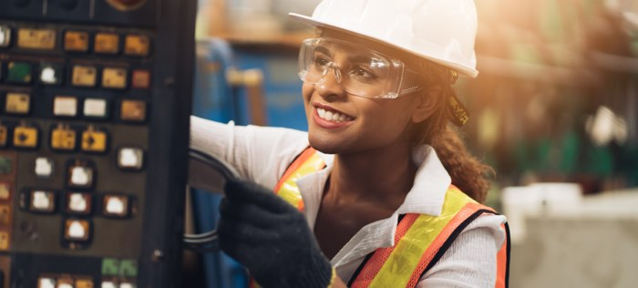 Woman in factory safety gear