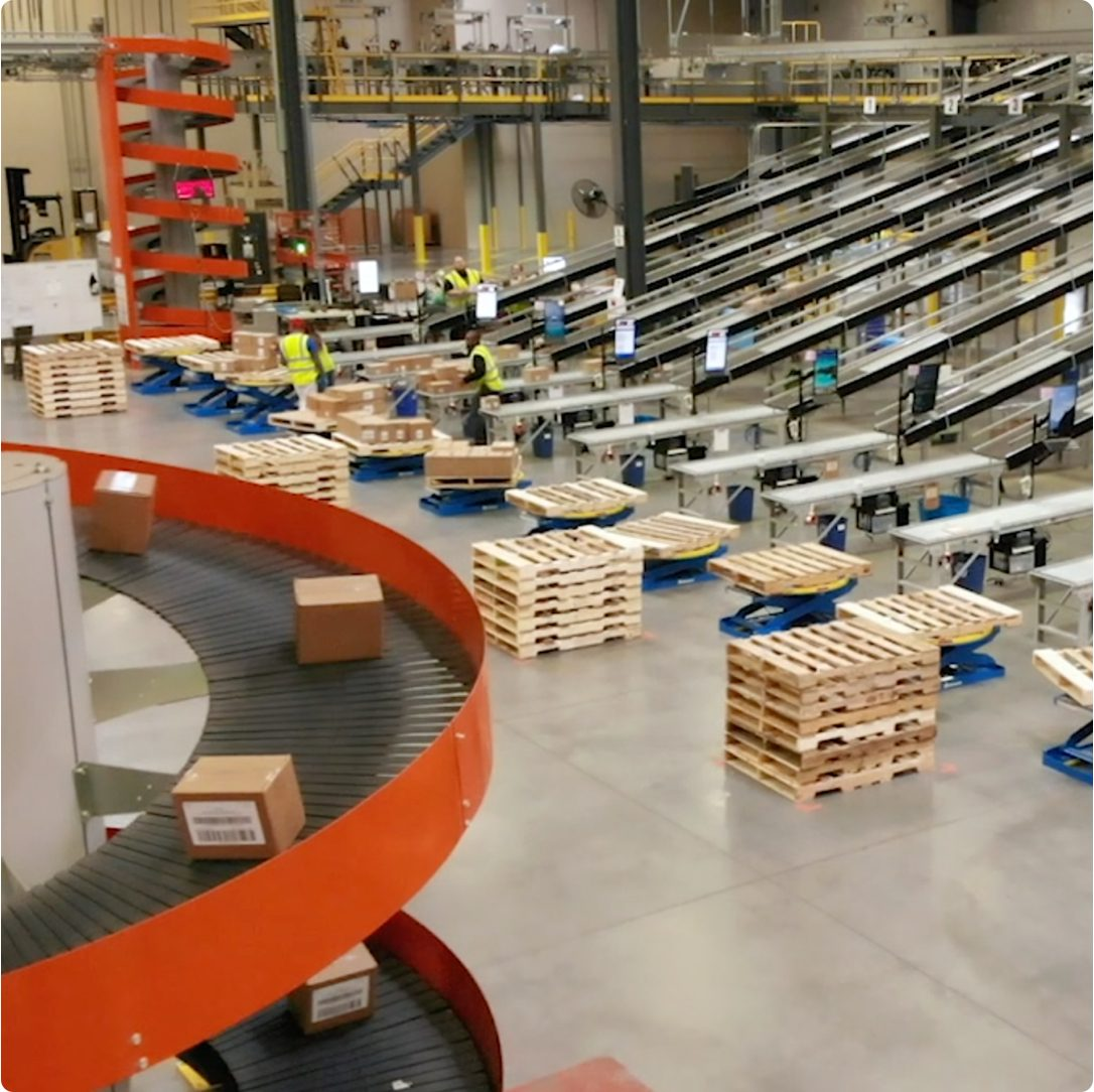 Warehouse facility with conveyers and pallet stacks