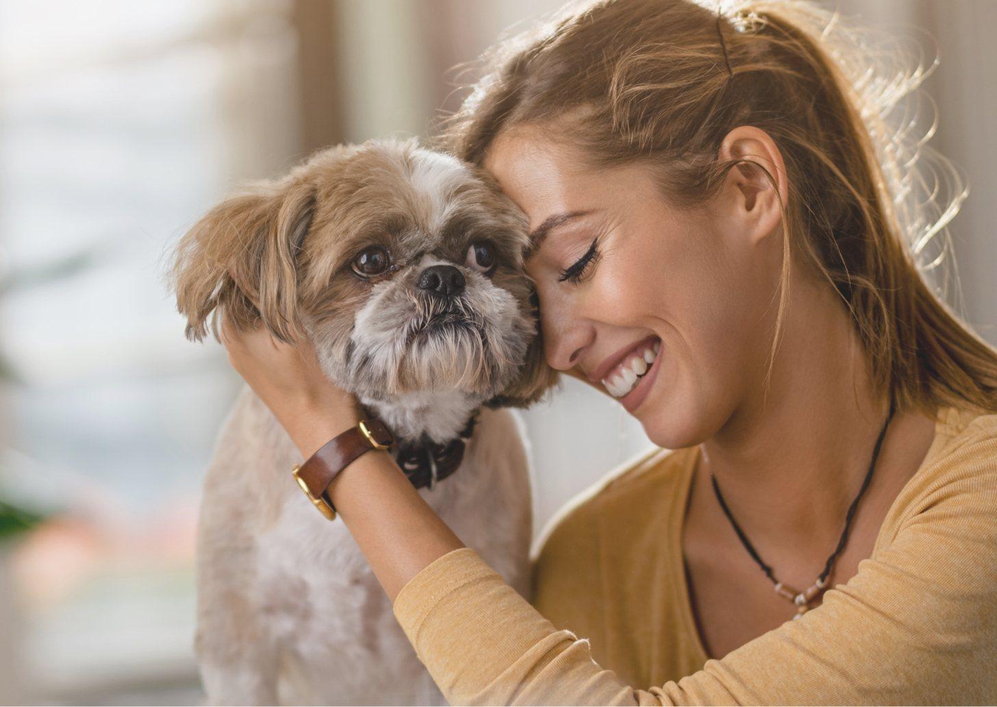 Woman hugging a small dog